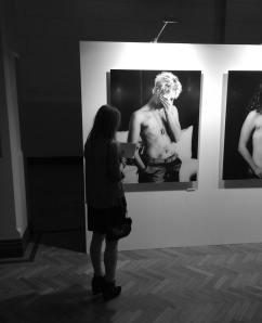 Heidi standing by Barbie's SCAR portrait.